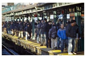 people standing on NYC train platform