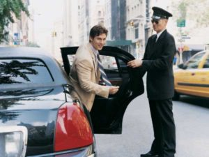 New York Limo service, man gettng out of a car with chauffeur